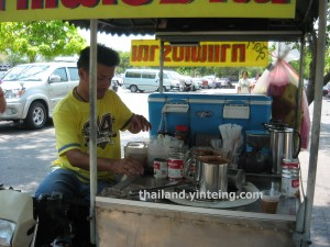 Roadside peddler selling coffee in Thailand