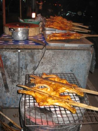Grilled chicken by the roadside in Thailand